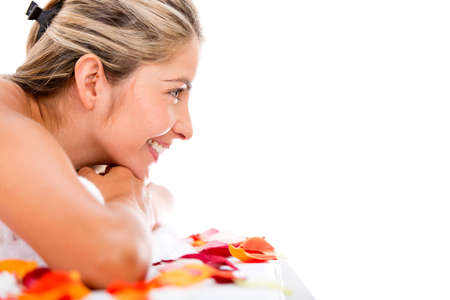 Happy woman at the spa - isolated over a white background Stock Photo - 17679940