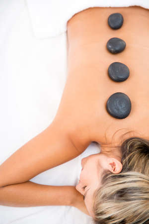 hot rock therapy: Woman getting a massage with hot stones