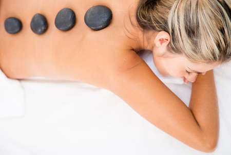 Woman getting a relaxing massage with hot stones Stock Photo - 17679911