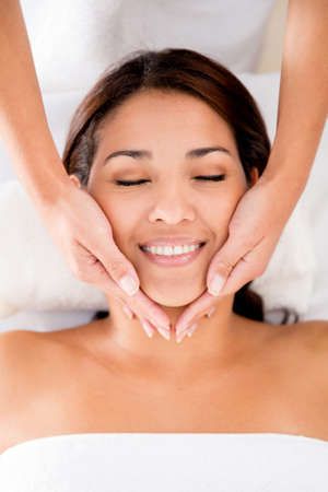 Relaxed woman at the spa getting a face massage Stock Photo - 17679883