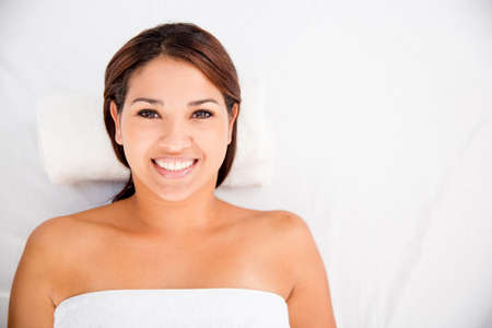 Beautiful Latin girl at the spa looking very happy Stock Photo - 17679893