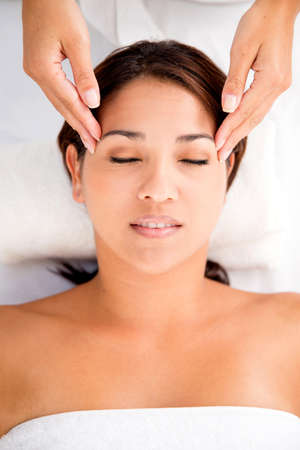 Woman enjoying a relaxing massage at the spa Stock Photo - 17679989