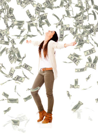 Excited woman under a money rain - isolated over a white background photo