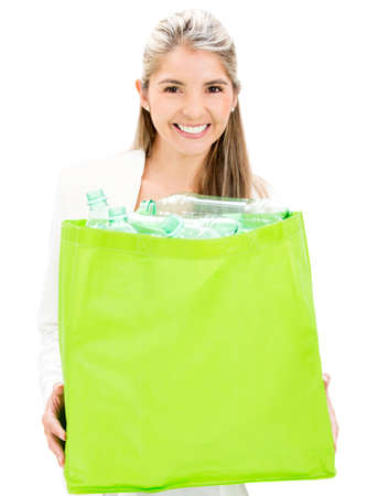 Woman recycling bottles - isolated over a white background photo