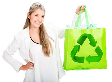 Woman recycling with a reusable bag - isolated over white photo