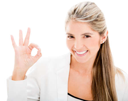 Business woman making an ok sign - isolated over white Stock Photo - 17679959