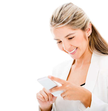 Woman texting on the cell phone - isolated over a white background Stock Photo - 17679847