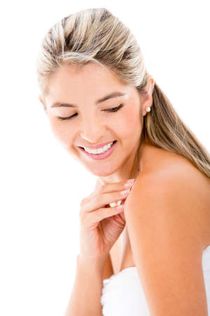 Beauty portrait of a woman stroking her shoulder - isolated Stock Photo - 17679943