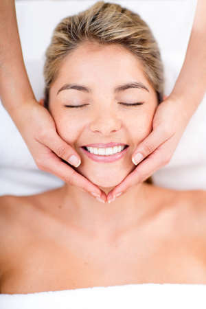 Happy woman relaxing at the spa with a massage Stock Photo - 17679838