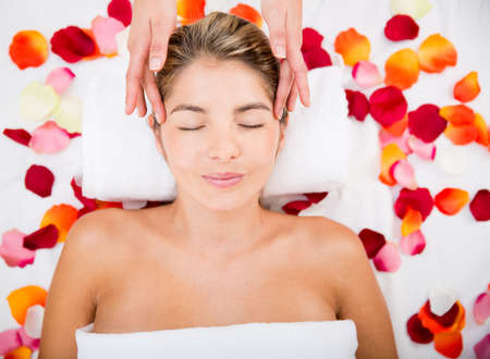 Relaxed woman getting a massage at the spa Stock Photo - 17679946