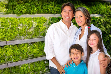 latin family: Healthy family buying groceries like fresh vegetables