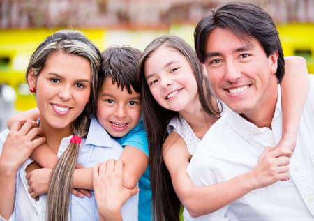 cafeterias: Happy family together at a restaurant and smiling Stock Photo