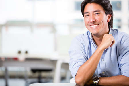 Handsome business man at the office smiling Stock Photo - 17749752