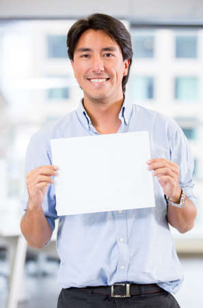 Welcoming business man holding a banner at the office Stock Photo - 17749747