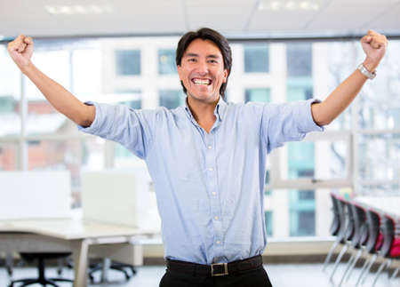 Successful business man with arms up celebrating Stock Photo - 17749743