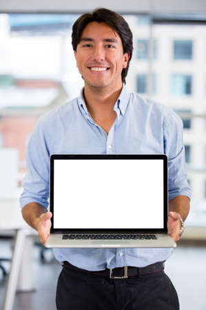 Business man showing something on a laptop screen Stock Photo - 17749745