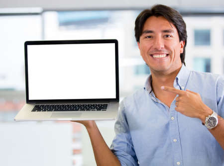 Businessman holding a computer and displaying the screen Stock Photo - 17749749
