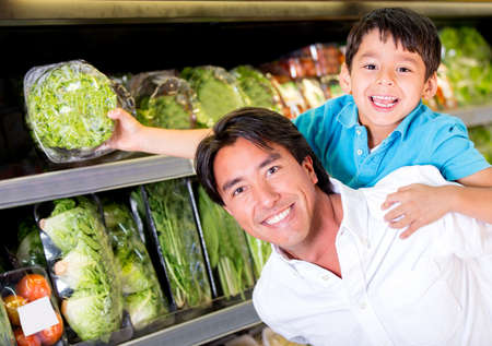 Father and son buying groceries at the supermarket photo