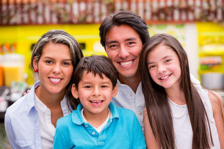 latin kids: Beautiful family portrait looking very happy and smiling