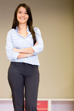 saleswomen: Confident saleswoman at a furniture store smiling Stock Photo