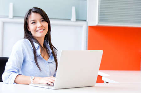 working: Successful business woman working at the office