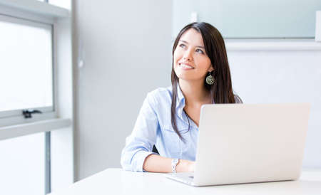 Penisve businesswoman working at the office on a laptop Stock Photo - 17784957