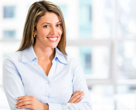 empowered: Friendly businesswoman looking very happy at the office