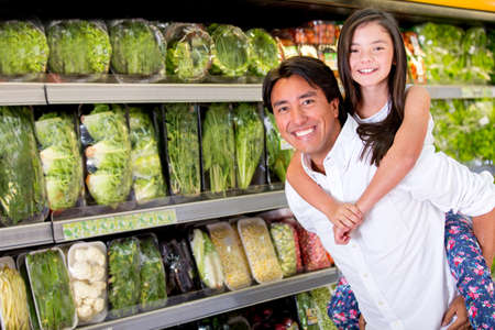 lifestyle home: Fun dad carrying her daughter at the supermarket
