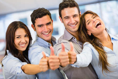 workers: Successful business group with thumbs up at the office