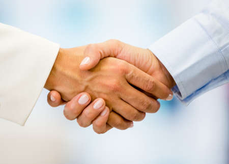 Business handshake closing a deal at the office photo