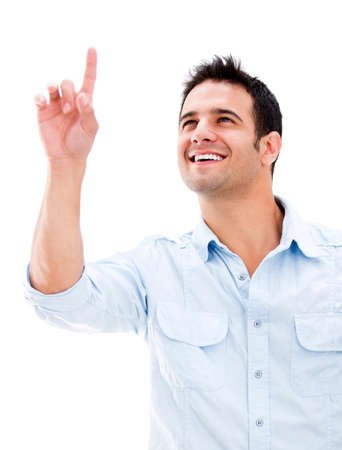 Casual man pointing up with his finger - isolated over white photo