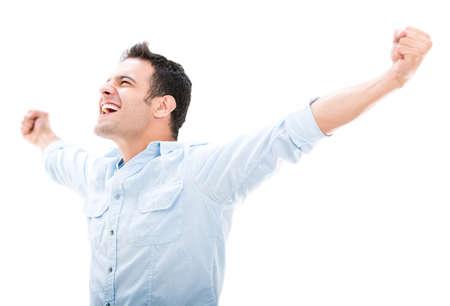 personas celebrando: Exitoso hombre que celebra con los brazos para arriba - aislados en blanco Foto de archivo
