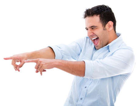 laughter: Man making fun of something laughing and pointing - isolated over white Stock Photo