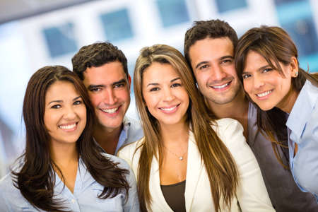 coworker: Successful business team at the office looking happy Stock Photo