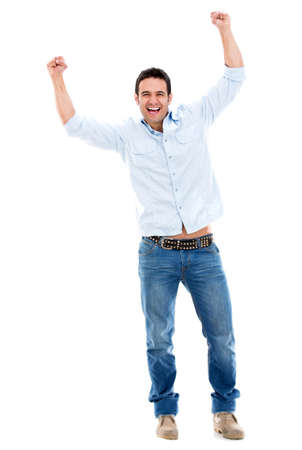 Successful man celebrating with arms up - isolated over white photo