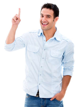 one finger: Excited man pointing a great idea - isolated over a white background