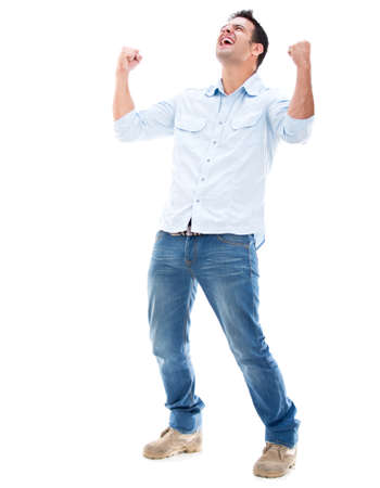 excited: Casual man winning and celebrating - isolated over a white background Stock Photo