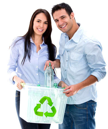 Green couple recycling bottles - isolated over a white background photo