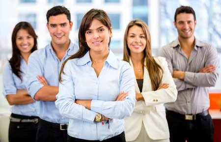 executive team: Successful business group smiling at the office Stock Photo
