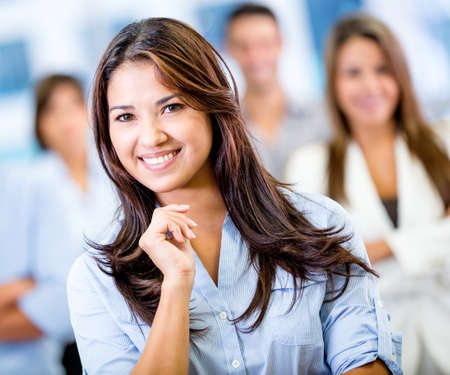 Happy business woman smiling at the office Stock Photo - 17925722