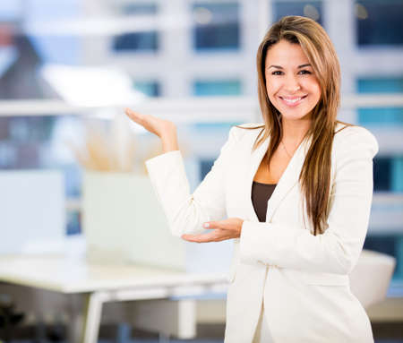 Welcoming business woman looking very happy at the office photo