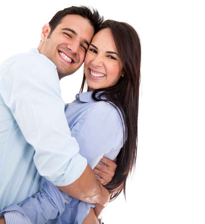 Beautiful affectionate couple smiling - isolated over a white background photo