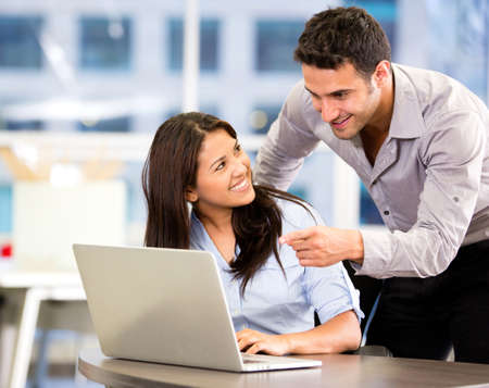 colleague: Business partners working at the office on a computer Stock Photo