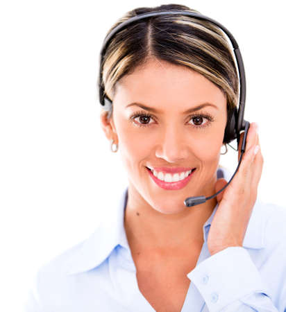 Female telemarketing agent wearing a headset - isolated over white photo