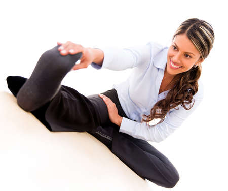 pause: Business woman stretching during an active pause - isolated over white