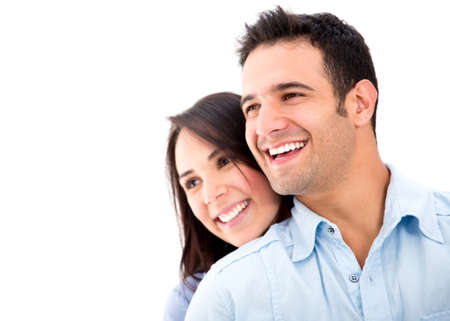 smiling women: Beautiful loving couple smiling - isolated over a white background