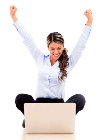 Business woman enjoying her online success - isolated over white Stock Photo - 18037954