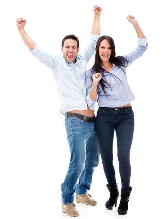 personas festejando: Pareja feliz con los brazos para arriba celebrando - aislados en blanco