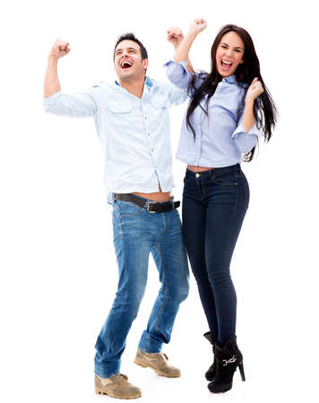 excited: Successful couple celebrating - isolated over a white background