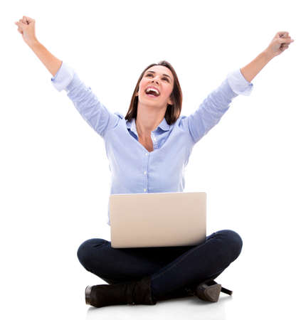 Successful woman with a laptop and arms up - isolated over white Stock Photo - 18024507